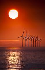 Sunset Over Irish Sea - New Brighton 2009 (Lee Carus) Tags: new sunset sea sun reflection brighton wind farm sony explore alpha 500mm a900 explored