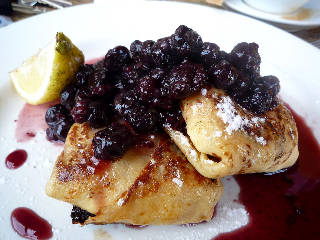 Cream cheese blintzes with stewed berries