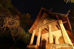 Wat Pa Huak - in a different light (... Arjun) Tags: wood longexposure light shadow 15fav texture architecture night 1025fav 510fav canon dark iso200 wooden asia glow different nightshot diverse unique buddha buddhist ghost radiance illumination surreal buddhism wideangle 100v10f noflash haunted special beam nightmarket late haunting ghosts unusual laos wat f11 mythology 2009 brightness mekong luangprabang startrails indochina singular distinctive uncommon luminosity luangphrabang atypical 17mm luangphabang unlike dissimilar louangphrabang phusi airavata bluelist polesapart laospdr unescoworldheritagecity canoneos5dmarkii watpahuak canonef1740mmf4lisusm 5dmarkii
