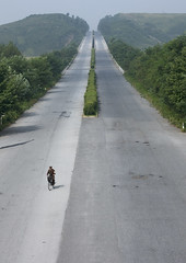 Soldier on a bike - North Korea highway (Eric Lafforgue) Tags: pictures travel soldier army photo war asia military picture korea explore kimjongil asie coree journalist militaire soldat journalists northkorea armee  dprk coreadelnorte 2650 juche 2560 kimilsung nordkorea lafforgue  ericlafforgue   coredunord coreadelnord  northcorea coreedunord rdpc  insidenorthkorea  rpdc   coriadonorte  kimjongun coreiadonorte
