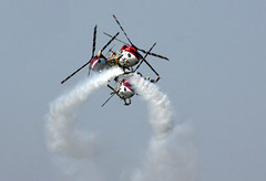 aero india 2009 - choppers stunt (vbsuresh) Tags: blue sky india danger flying high scary team display glory smoke air bangalore trails exhibition planes saras helicopters pilots guts choppers stunts daring indian air force bengaluru show work 40d team 2009 surya aero kiran