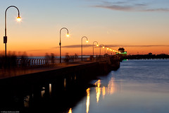 Ghosts of St Kilda (WilliamBullimore) Tags: longexposure sunset people moon motion reflection water lights evening wooden twilight dusk au australia melbourne victoria crescent motionblur kiosk stkilda humans crescentmoon portphillipbay stkildapier canonef70200mmf28lisusm canonrc1wirelessremote manfrotto190xbtripod canoneos5dmarkii manfrotto322rc2heavydutygripballhead