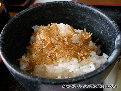 Close-up of the rice, served with small salted fish
