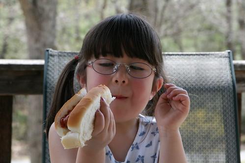 Eyeing her hotdog