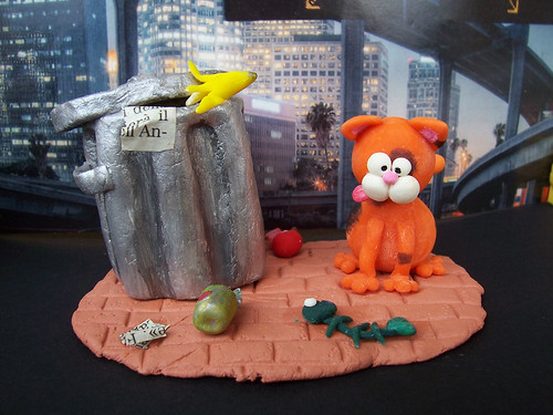 My paradise is a full dustbin and a fish-bone... - Miniature scene with a city cat (Hugo the Cat) and his treasure 1