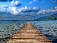 Tiny Ducks Fall Asleep on a Dock (kugel) Tags: blue sky lake water animals clouds germany landscape bavaria dock europe horizon sunday ducks perspectives explore vegetarian dreams utata fujifilm labourday tegernsee kugel coth explored abigfave coth5