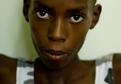 Living on a Prayer (Dan Bachmann) Tags: africa travel portrait face kids geotagged place canon20d uganda headshots ethnic 2009 eastafrica individuals karamoja geo:lat=244568667 geo:lon=3439503833