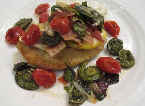 Chicken picatta topped with fiddlehead ferns and tomatoes