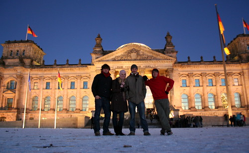 four friends in front of the Berlin Parliament