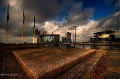 Across The Dock (Digit@l Exposure) Tags: sky clouds docks fence manchester dock flags salford quays aluminium loery