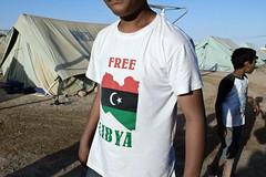 Remada refugee camp, Tunisia (5) (Tom Szustek) Tags: boy photography photographie tunisia refugee refugees photojournalism tshirt libya unhcr tunisie libyan fotojornalismo refugeecamp tunezja photojournalisme fotojournalismus rfugis uchodcy arabspring remanda freelibya