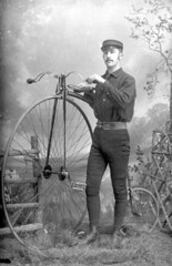 Laurie A. Perkins with a Penny-Farthing bicycle