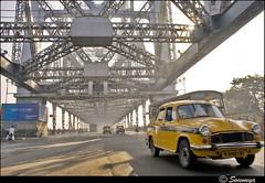Howrah Bridge | Kolkata ($owmya) Tags: street travel india canon photographer taxi kitlens kolkata sow westbengal howrahbridge howrah yellowtaxi sowmya cityofjoy 400d canon400d typicalkolkata owmya incrediblebengal photographybysowmya sowmyasphoto photographybysowmyaaiyappa photographybyowmya owmyasphotostream copyrightbysowmya sowmyasphotography