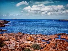 Paisaje (enara ibz) Tags: sea paisajes beach sanantonio clouds mar playa paisaje ibiza nubes eivissa rca playas rocas baleares