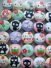 Hello Kitty cupcakes ( gabby cupcakes by Gabriela Cacheux) Tags: pink flowers blue art cakes yellow design cupcakes sweet hellokitty kitty craft sugar kawaii badtzmaru chococat keroppi fondant mymelody gabbycupcakes