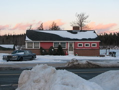 House with Town Car (The Stakhanovite Twins) Tags: santa street roof winter lake snow canada brick ford car novascotia canadian lincoln suburbs manhole halifax towncar bushes manholecover bungalow snowbank diagonals lincolntowncar schachtabdeckung timberlea stmargaretsbayroad