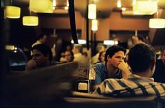 La distanza fra persona e riflesso (Emmanuele Contini) Tags: bar persona istanbul ritratto diapositiva riflesso analogico scattorubato contnibb fotografinewitaliangeneration resistenzaanalogica scattorubatto
