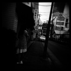 Mystery Woman (gullevek) Tags: 6x6 epsongtx900 japan tokyo   holga120cfn blackandwhite  fuji fujineopanpresto400 wires electricity dark japanesepeople japanesepersons japanese japanesegirl iso400   car street pole writing sign skirt shoes geo:lat=35567682 geo:lon=139692321