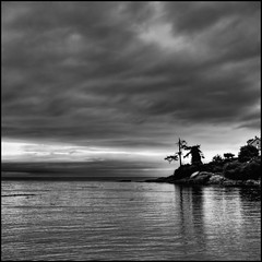 Ressentiment (ecstaticist) Tags: sky bw cloud white house canada black reflection building beach water silhouette vancouver square de island bay exposure bc gonzales juan 5 five ominous ripple horizon wave victoria casio windswept weathered gloom straight knarly hdr strait fairfield windblown glassy outcropping fuca knarled tonemapped ressentiment exf1