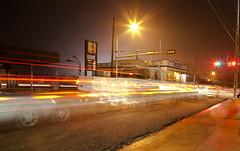 Congestion (pearmon) Tags: longexposure blur streets cars night lights trafficlight traffic gasstation roads lockhart pfogold pfosilver