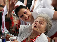 a health service in Zurich (richard thomson) Tags: old red white smile energy power candid zurich young patient hauptbahnhof streetparade nurse lipstick redbull reaction sortof shriek interraction powelessness