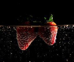 The bubbles just love the strawberries! (Kim van Dijk photography) Tags: red two black macro green water closeup fruit strawberry air bubbles drop droplet blueribbon goldenmix mywinners abigfave platinumphoto citrit theunforgettablepictures macromix wonderfulworldmix macromarvels goldstaraward mallmixstarawards kimvandijk