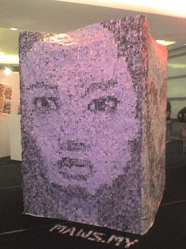 3D newspaper collage of a face