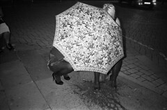 (Dr Karanka) Tags: street uk wales night umbrella flash cardiff ilfordhp5 rodinal puke vomit olympusxa blackandwhitefilm girlshiding