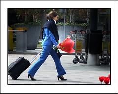 De mens en zijn......./  The man and his.... (Theo Kelderman) Tags: people woman holland netherlands nederland schiphol vrouw bloemen 2010 mensen boeket stewardes amsterdamairport theokeldermanphotography demensenzijn themanandhis