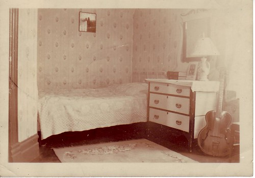 Alan Chan's bedroom on Keefer Street, with electric guitar