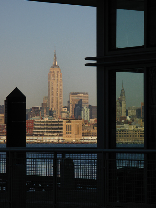 composition with the Empire State Building, Chrysler Building, the Hudson River, and a ferry terminal