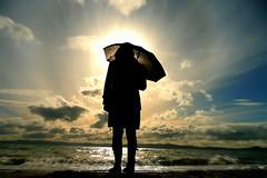 Umbrella Girl (Michael Winkler) Tags: sky beach silhouette clouds umbrella bay katy heart alameda valentinesday blueribbonwinner kartpostal mywinners abigfave platinumphoto colorphotoaward aplusphoto tz3 theunforgettablepictures michaelwinkler