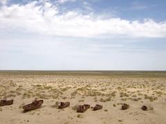coastline (neil banas) Tags: sky cemetery landscape dead ruins asia sad desert central silkroad slideshow uzbekistan rtw crumbling moynaq aralsea karakalpakstan lpdesert lpdamaged lpdeserts