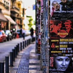 athenian colonnade:  124/365 (helen sotiriadis) Tags: street canon advertising published dof bokeh columns athens depthoffield greece sidewalk posters 365 canonef50mmf14usm  canoneos40d    toomanytribbles