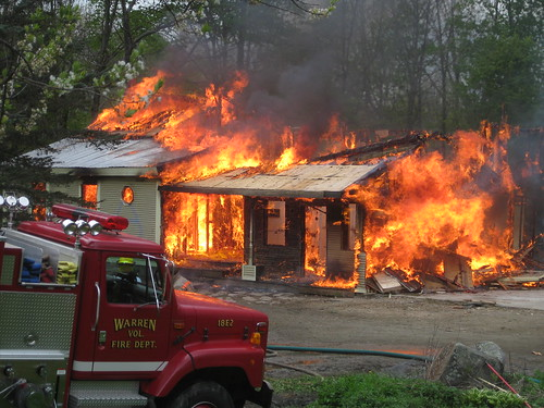 the housing market is burning down, just like this house
