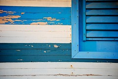 Beach House (lynn.h.armstrong) Tags: camera wood blue light vacation white house ontario canada art beach window lines azul dark lens geotagged photography photo interesting boards mac aperture nikon rust long peeling paint flickr shadows zoom south cuba may rusty lynn h nails shutters iberostar laguna nikkor varadero armstrong stormont vr afs gettyimages dx sault ingleside 2011 ifed 18200mm f3556 attributionnoderivs vrii d7000 ccbynd lynnharmstrong requesttolicence