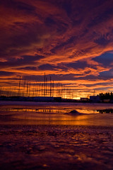 Intensunset (jonmartin ()) Tags: winter sunset orange ice boats purple
