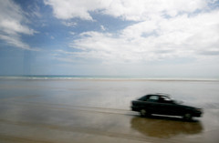 we'll be driving away (claire barnes) Tags: newzealand sky colour beach water beautiful car speed landscape solitude mood driving scenic scene abandon remote isolation melancholy abandonment carefree emptiness 90milebeach exhileration drivingaway
