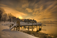 Glow of Hope (mortenprom) Tags: ocean morning bridge winter light sea sky orange sun snow plant black color reflection tree ice beach nature water yellow oslo norway stone clouds sunrise landscape island golden boat norge sand gate rocks ship tripod skandinavien norwegen wideangle explore shore noruega scandinavia peninsula 2009 footprint hdr goldenhour oslofjord februar habour huk noorwegen noreg wideangel sigma1020mm skandinavia nd1000 nd30 bw110 skycloudssun flickrenvy canoneos40d nd1000x naturaldensityfilter mortenprom
