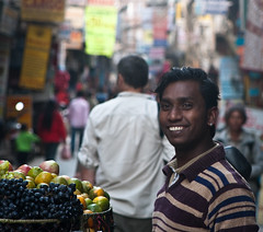 Do you want to buy some fruit? (Chrissie64) Tags: nepal portrait people man face smiling fruit happy person dof emotion bokeh expression places kathmandu streetvendor interaction thamel stphotographia