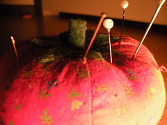 two sides (melonscope) Tags: lighting red macro warm pins clear needles cushion tomoto