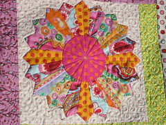 Dresden Plate from colorful wall hanging (Julie Antinucci) Tags: quilt sewing logcabin quilting patchwork kaffefassett amybutler wallhanging scrappy dresdenplate heatherbailey annamariahorner joeldewberry quiltingpatterns