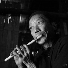Reflective music flute play (NaPix -- (Time out)) Tags: portrait bw music man black 6x6 face canon square asia spirit flute bamboo vietnam explore soul top10 emotions sapa hmong exceptional 500x500 explored explorefrontpage exploretopten napix winner500
