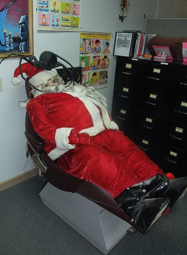 Santa Claus in Dentist Chair With Cockroach