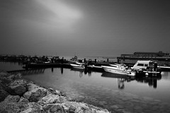 Silent Moment (MJ ) Tags: sea bw white black reflection water canon boats eos boat marine rocks silent filter 1855mm moment filters efs doha qatar 2010 pl alkhor    nd4  40d