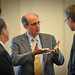 Green Energy Corp. chairman Dan Gregory (center) chats with panel members.