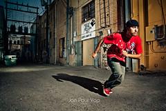Chased (Jan Paul Yap) Tags: usa aka downtown backalley pentax tx running poetic mc mcallen rapper rhyme inaction chased strobist vivitar285hv da1650 k200d cactusv2s micartttt crazyrestless perfectactionshot runfromkneelingposition roybazan