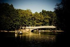 The Bow Bridge (elrina753) Tags: nyc newyorkcity people usa lake newyork boats pond unitedstates centralpark manhattan lakes bridges upperwestside ponds rowboats bowbridge boaters