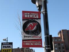 A NJ Devils banner outside the Prudential Center, Newark (Hazboy) Tags: ice sports hockey rock nhl newjersey devils sanjose national skate jersey sharks newark sanjosesharks league prudentialcenter lnh newjerseydevils njdevils   hazboy hazboy1 hasznlatos