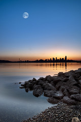 Alki Beach Sunrise (Cynthia.Lou) Tags: city seascape reflection water sunrise landscape rocks cityscape westseattle alkibeach spaceneedle washingtonstate discoverypark downtownseattle cynthialou canon5dmark2 vosplusbellesphotos